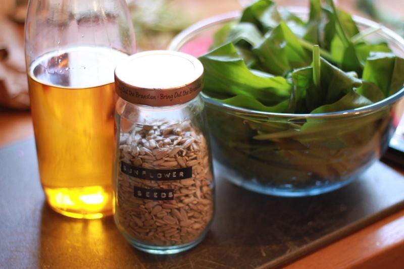 Wild garlic, oil and sunflower seeds