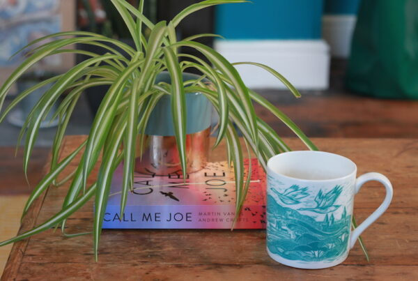 A plant, a book and a mug